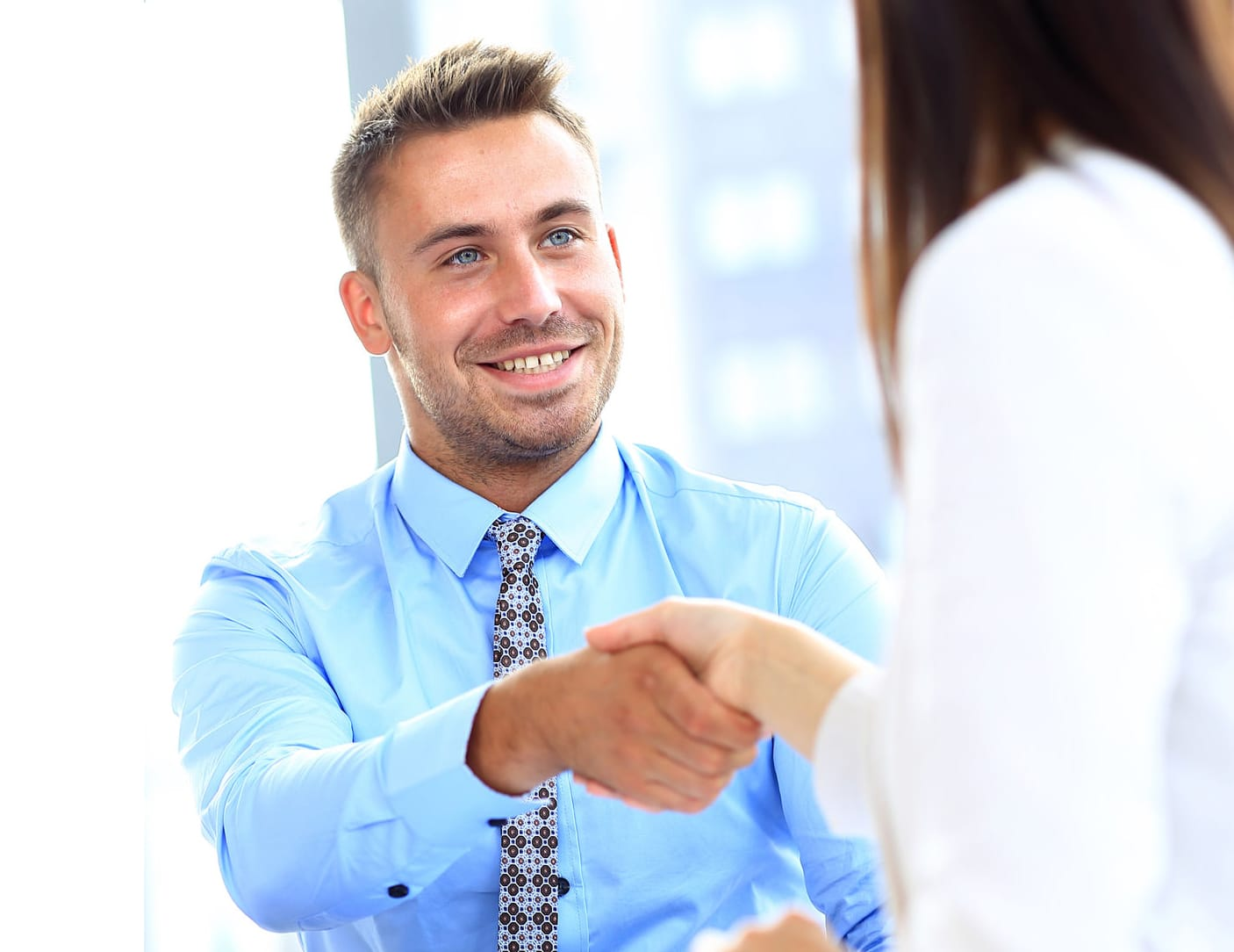 51567863 - businessman shaking hands to seal a deal with his partner
